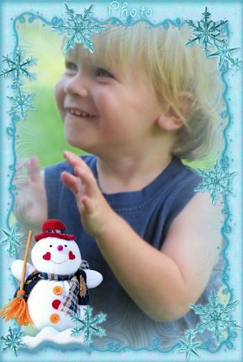 Marco navideño con un muñeco de nieve